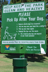 Park sign: Pick Up After Your Dog